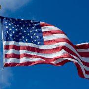 us flag waving against a blue sky