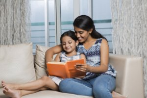 Take turns reading a book. Your kids will improve their skills and you'll share a great bonding experience.