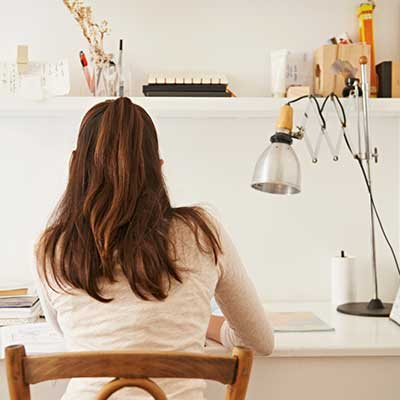 student studying at desk in bedroom