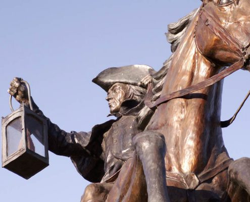statue of Paul revere on his horse with a lantern