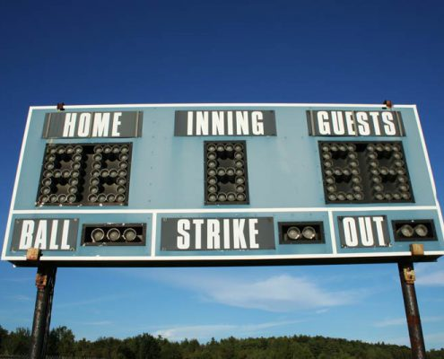 scoreboard with blue sky
